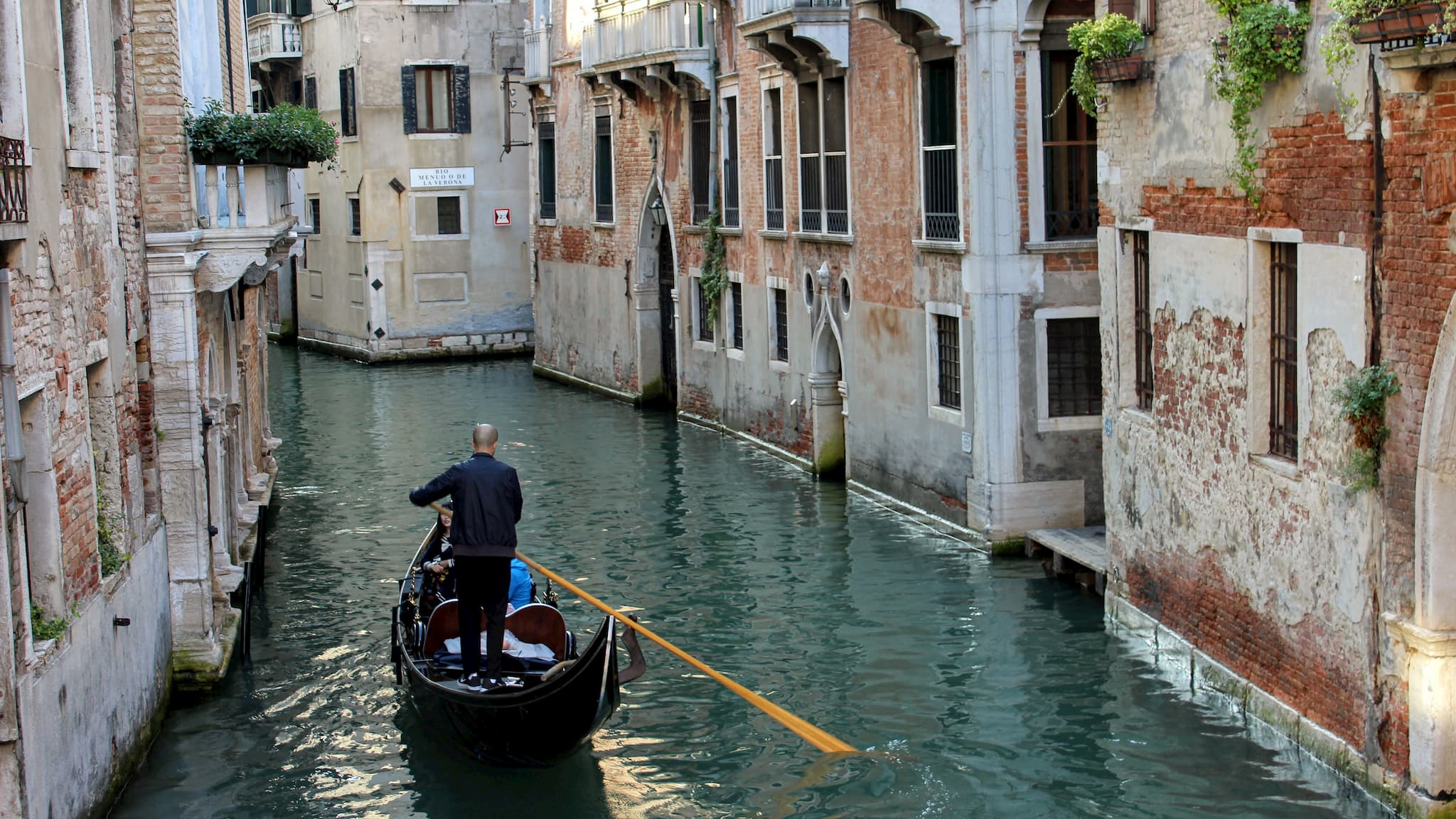 Gondola boat traveling down Venice canal